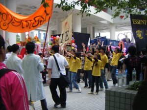 Students from a club performing a choreographed dance to attract new members. Good luck, guys.