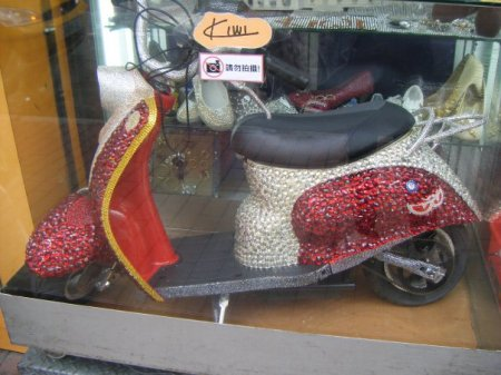 Completely and totally bedazzled scooter. Obviously someone needs a new hobby.
