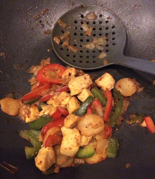 A small portion of the finished product in the wok.