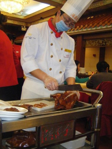 The chef slicing up our official Peking duck, tableside.