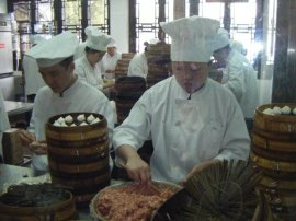 The experts churning out thousands upon thousands of Xiao long bao for the hungry masses.