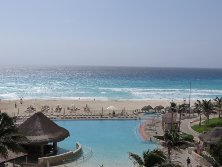 The view of the hotel pool and ocean from our room's balcony. Don't deny you're jealous.
