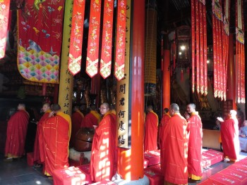 The monks in residence at the Jade Buddha temple in Shanghai praying and chanting.