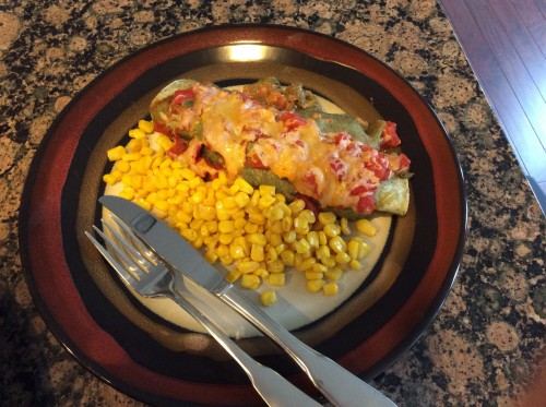 plated beef and spinach enchiladas