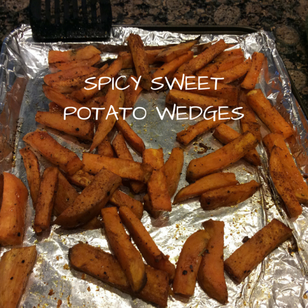 spicy sweet potato wedges on baking sheet